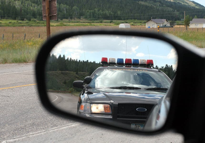 police car seen in the side mirror