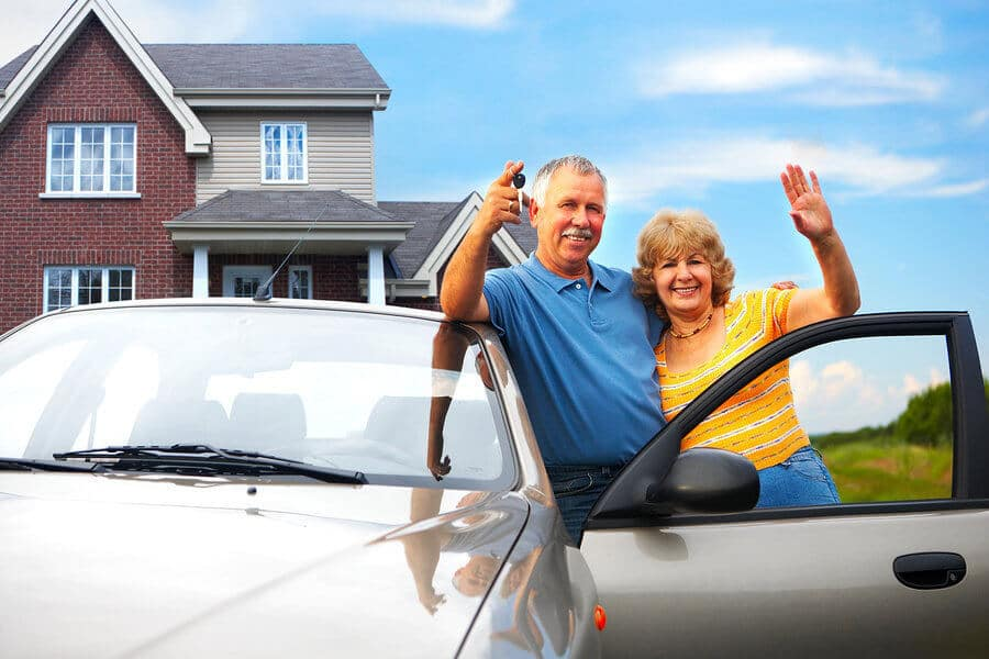 Couple with their car and car insurance