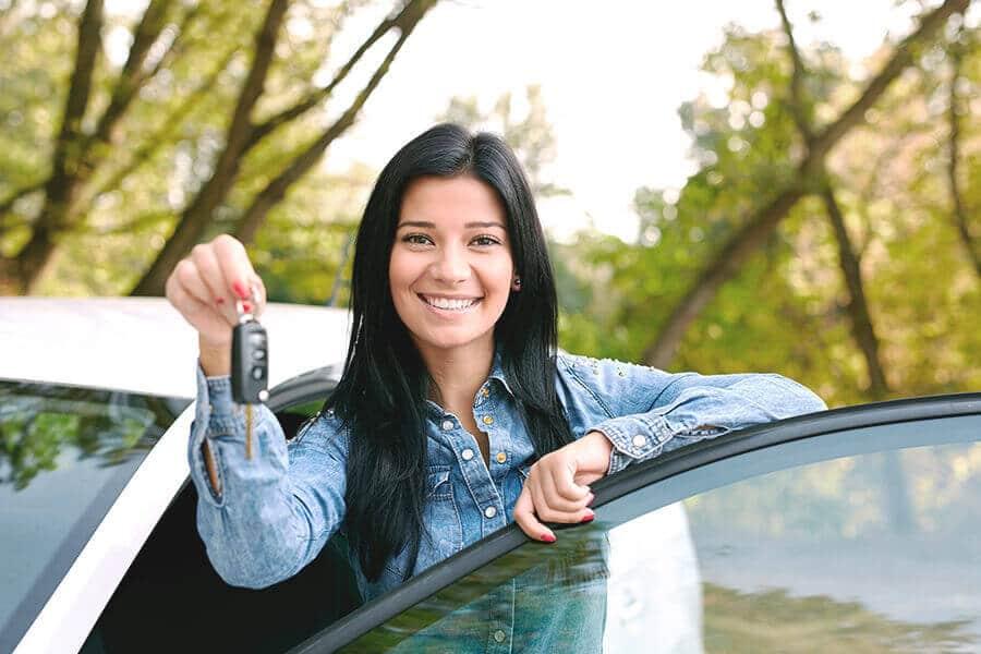 Lady driver holding car keys