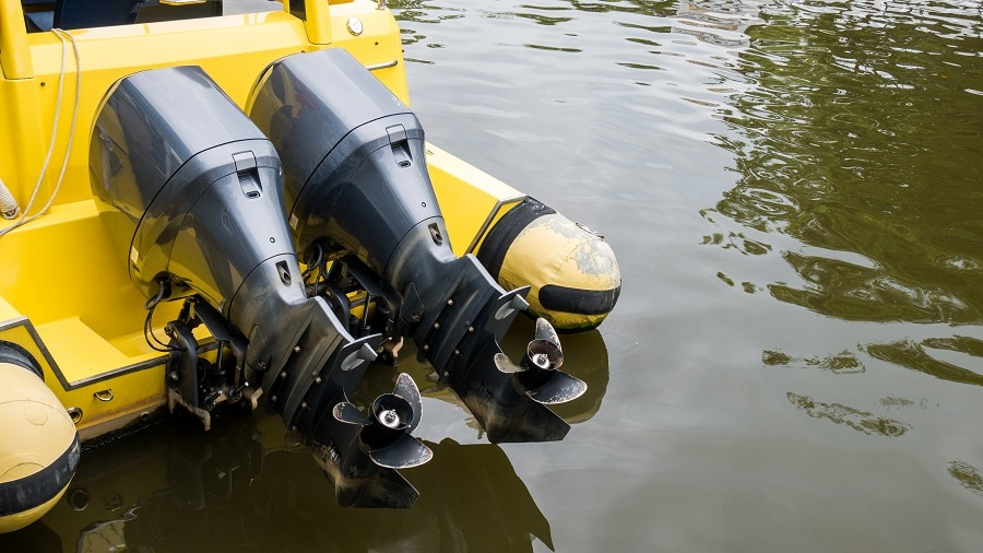 yellow boat with blown engine