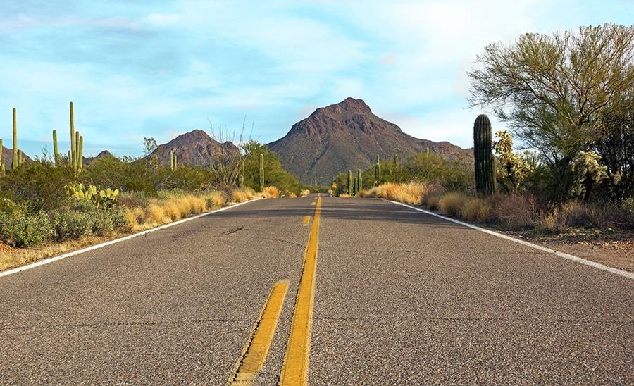 Highway runs through the Sonoran desert leading to the mountain peak